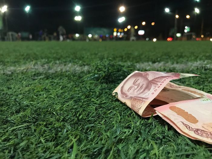 Grass Night Green Color Currency No People Illuminated Outdoors Close-up Sport Soccer Artificial Green Football Ball People Money Thai Bath Red