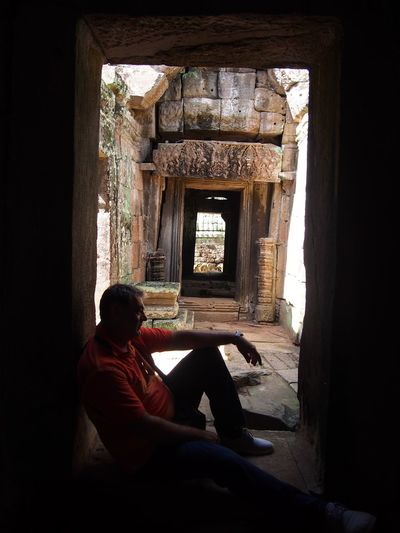 Real People Architecture One Person Window Sitting Built Structure Religion Spirituality Building Relaxation Sunlight