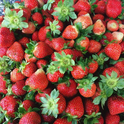 Full Frame Shot Of Strawberries For Sale In Market