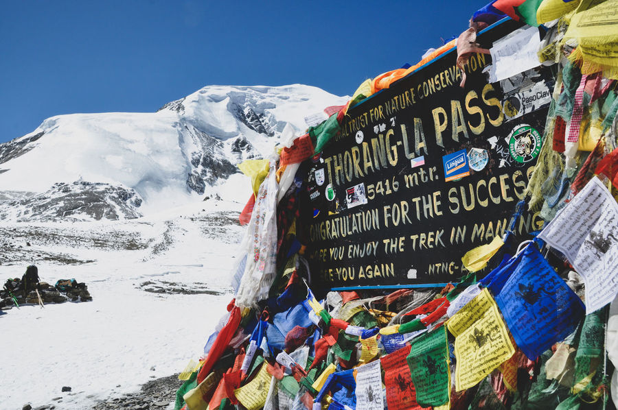 Thorong La Peak Summit Annapurna Conservation Area Nepal Trekking Treker Colourful Adventure Mountain Multi Colored Snow Flag Religion Sky Mountain Range Prayer Flag Snow Covered Mountain Peak A New Beginning