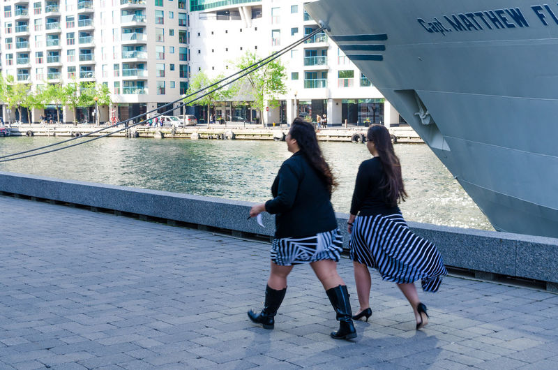 Architecture Break Time Building Built Structure Casual Clothing City City Life City Street Day Full Length Girls Going For Work Harbour Leisure Activity Lifestyles Monday Workout Outdoors Receptionist Street Photography Uniform Walking