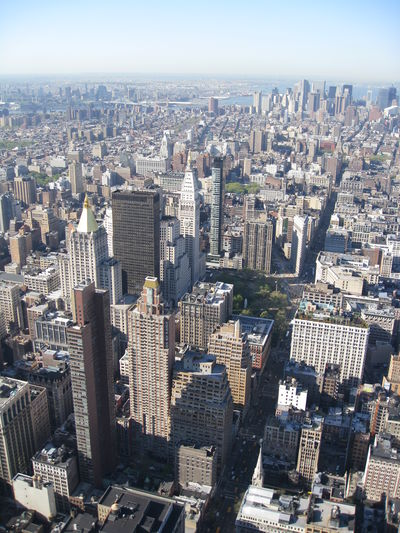Aerial view of buildings in city against sky new york