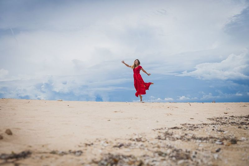 Beach Child Playing Sand Full Length Nature Males  One Person Outdoors Day Vacations People Cloud - Sky Cheerful Sky Childhood Musical Instrument Sand Dune Adult Human Body Part Sea Water Beautiful Woman Vacations