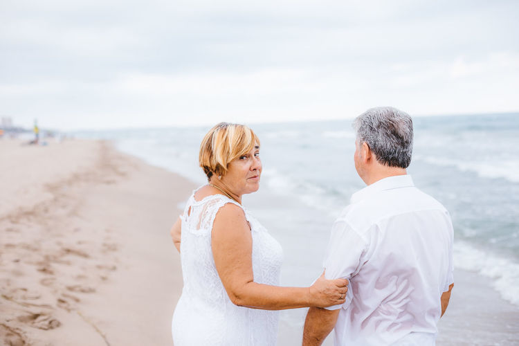 Beach Sea Togetherness Two People Love Men Land Emotion Couple - Relationship Positive Emotion Water Adult Bonding Wedding Heterosexual Couple Day Real People Standing Celebration Mature Men Outdoors