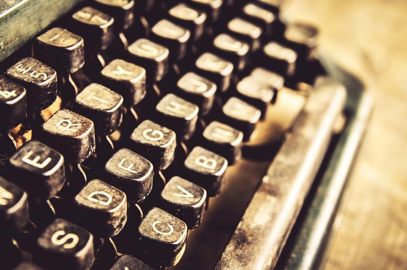 Close-up of abandoned typewriter on table