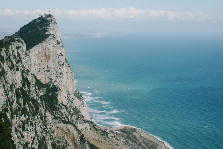Steep cliff at rock of Gibraltar at Mediterranean Sea Beach Beauty In Nature Cliff Day Gibraltar Gibraltar Rock Horizon Over Water Horizontal Mediterranean Sea Nature No People Ocean Outdoors Rock - Object Scenics Sea Sky Steep Tranquil Scene Tranquility Water