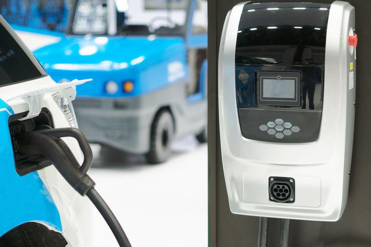 Close-up of car charging at station
