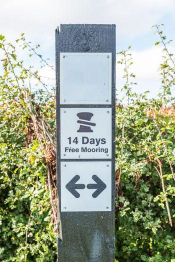 Morning view 14 Days Free Mooring sign stand 14 Boat Close-up Communication Day Days  Free Guidance Mooring No People Outdoors Parking Sky Text Tree