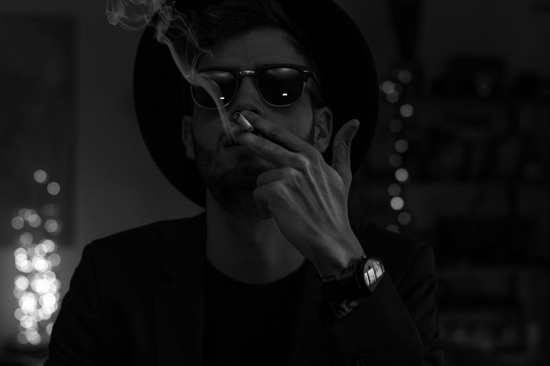 Young Man Wearing Sunglasses Smoking Cigarette