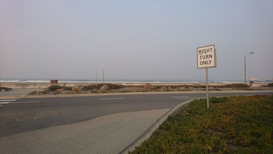 Right turn only. San Francisco SF California CA United States USA Ocean Beach Ocean Beach San Francisco Right Turn Right Turn Only Sign Street Sign Highway Freeway Misty Foggy Smoke Dunes Urban Landscape Road Sign Road Sky Landscape