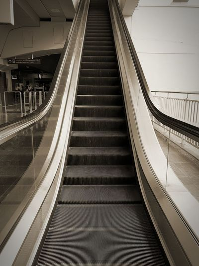 Low angle view of escalator in building