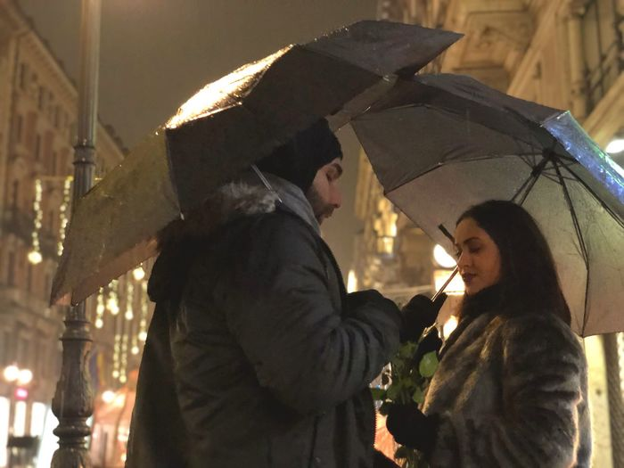 Beauty Light Rain Roses Love Romance Romantic Umbrella Man Woman Two People Men Adult Women Hat Togetherness Emotion Couple - Relationship Bonding Clothing Illuminated Love Positive Emotion Portrait Side View Heterosexual Couple People Night Happiness Smiling Human Connection A New Perspective On Life Moments Of Happiness