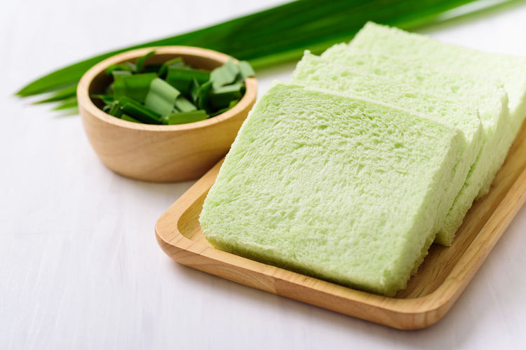 Pandan drink in the glass with pandan leaf,healthy drink in Asian Pandanus Thai ASIA Asian  Baked Bakery Bowl Bread Breakfast Cooking Delicious Eating Food Green Health Healthy Homemade Ingredient Leaf Leaves Nature Pandan Plant Sweet White Healthy Eating Wellbeing Studio Shot Cutting Board