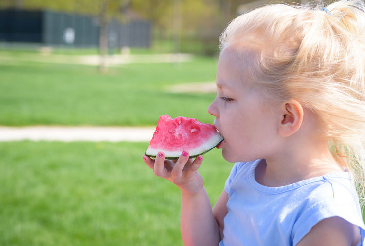 Close-up of girl with ice cream against blurred background