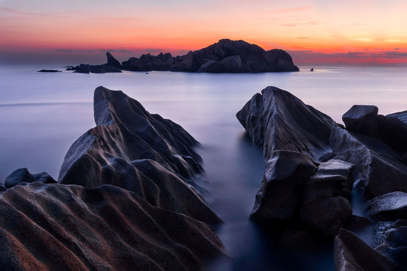 Beauty In Nature Sky Sea Sunset Water Rock Scenics - Nature Solid Rock - Object Tranquil Scene Tranquility Cloud - Sky Idyllic Long Exposure Nature Rock Formation Beach Horizon Over Water No People Sunrise Capture Tomorrow