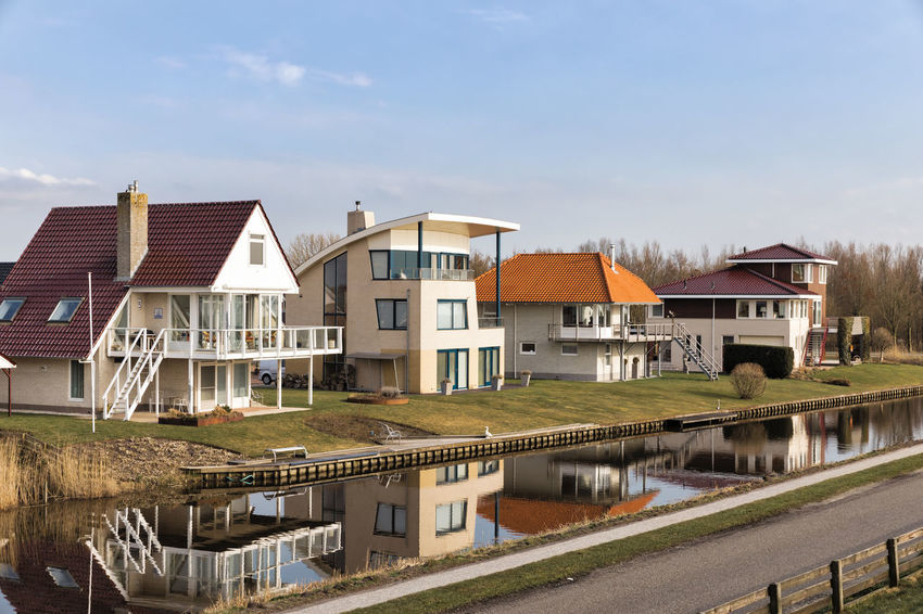 Modern detached houses on the waterfront of a town canal in Hindeloopen, Netherlands. Architecture Façade Hindeloopen Home In A Row Modern Modern Architecture Netherlands Reflection Building Exterior Built Structure Detached House Friesland Front Or Back Yard High Angle View House Luxury No People Residential Building Residential District Residential Structure Town Canal Villa Water Waterfront The Architect - 2018 EyeEm Awards