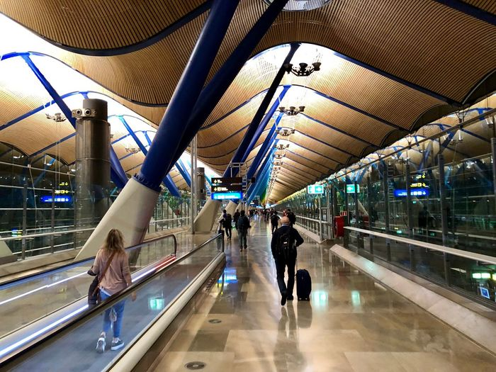 Barajas Airport... Scenics Travel Destinations Aroundtheworld Tourism Architecture Built Structure Real People Group Of People Men Incidental People Lifestyles Transportation Crowd Large Group Of People Railing Group Travel Illuminated Modern Indoors  City Ceiling Women