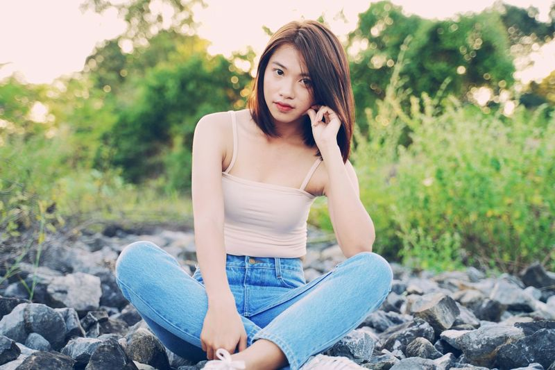 Shorthair Asian Girl Child Long Hair Denim Jeans Tank Top Hand In Hair Pink Lipstick  Posing