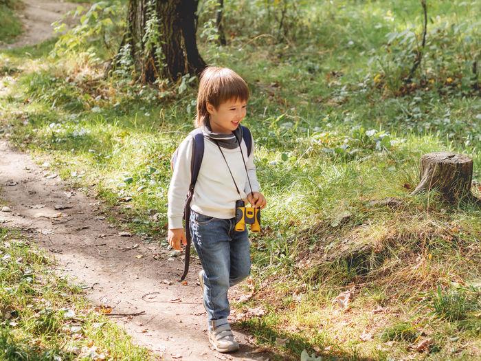 Full length of cute boy standing on land
