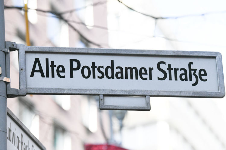 Alte Potsdamer Strasse street name sign. The place is the new modern city center and financial district of Berlin, Germany Alte Potsdamer Straße Berlin Architecture Close-up Communication Focus On Foreground Germany Nameplate No People Outdoors Street Name Street Name Sign Street Names  Street Sign Text Topography Western Script