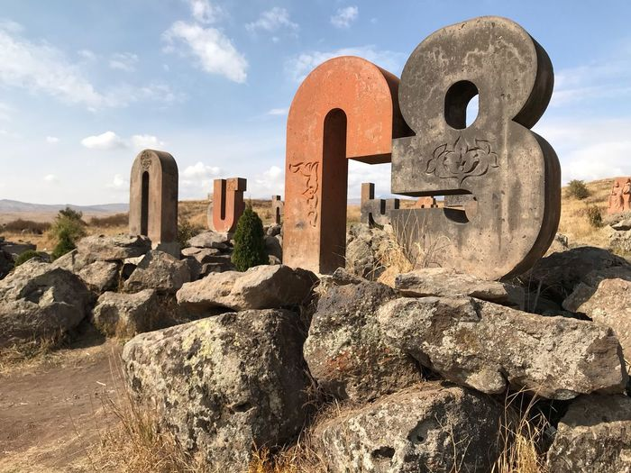 Old Armenian Alphabet EyeEm Selects Nature Sky Architecture Sunlight Cemetery No People Cloud - Sky Built Structure Grave Day Solid Tombstone History Shadow Stone Memorial The Past Land Outdoors Ruined