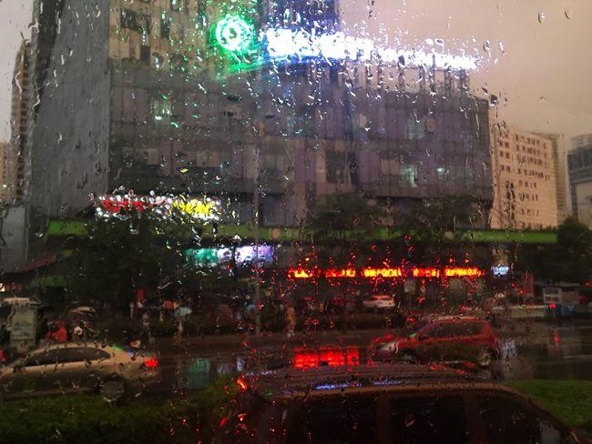 CHINA 🇨🇳 Wet Rain Car Architecture Illuminated Building Exterior Night Window Built Structure City RainDrop Water Outdoors