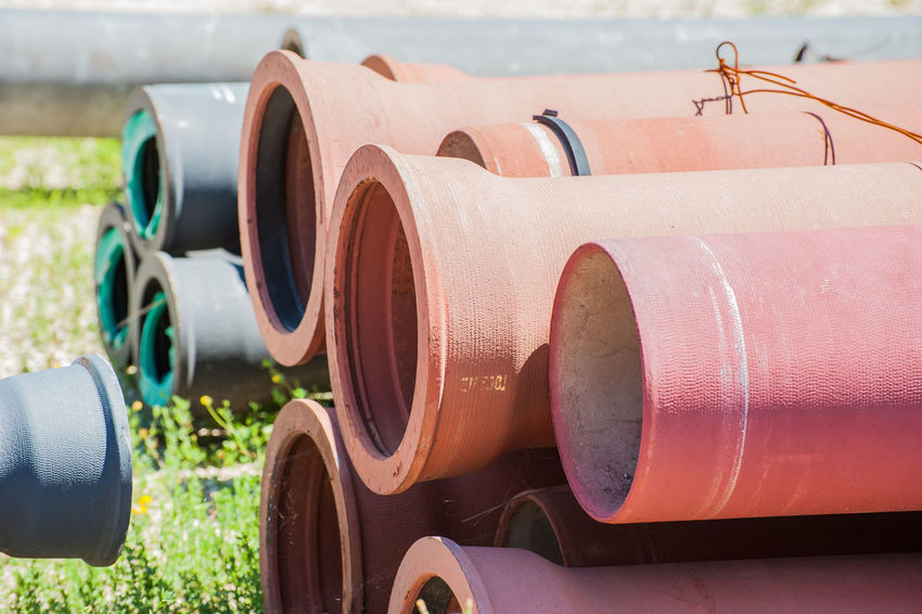 Plastic pipes for drains water for building Construction Industry Stack Close-up Day Drainage Ducts Outdoors Pipes Plumber Sewage Tubes