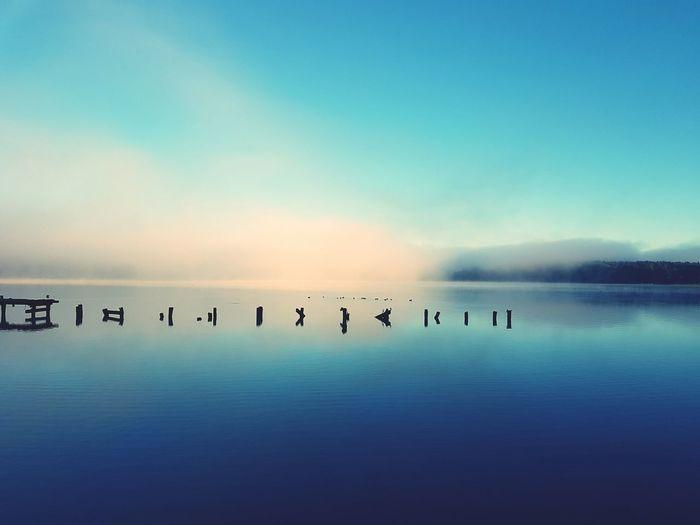 Scenic view of lake ukiel against sky during sunrise