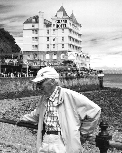 Elderly Old Man Elderly Man Blackandwhite Grand Hotel Wales Llandudno People People Watching EyeEm EyeEm Best Shots Pier Llandudnobeach Back In Time Back In The Day Time Lapse Hotel Sea Beach Outdoors Daytime Casual Clothing People And Places Monochrome Photography