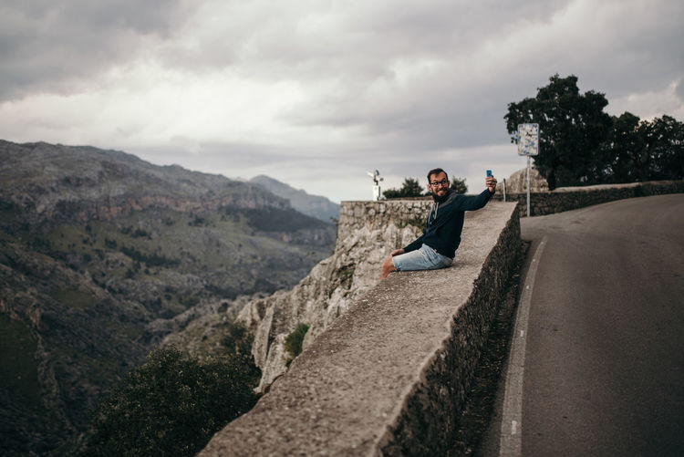 lonesome man standing at viewpoint of Puig Major on Mallorca, Spain Loneliness Mallorca Mallorca (Spain) Man Melancholic Landscapes Moody Sky Puig Major Beauty In Nature Cloud - Sky Day Human Leisure Activity Lifestyles Mallorcaisland Man Taking Selfie Men Mood Mountain Nature Outdoors Real People Scenics - Nature Selfie Sky View Point