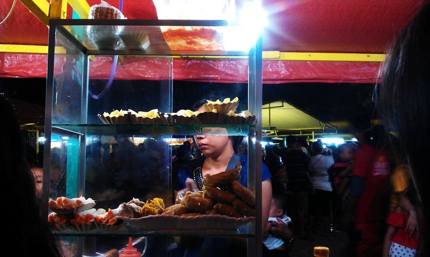 Midsection of woman at market stall at store