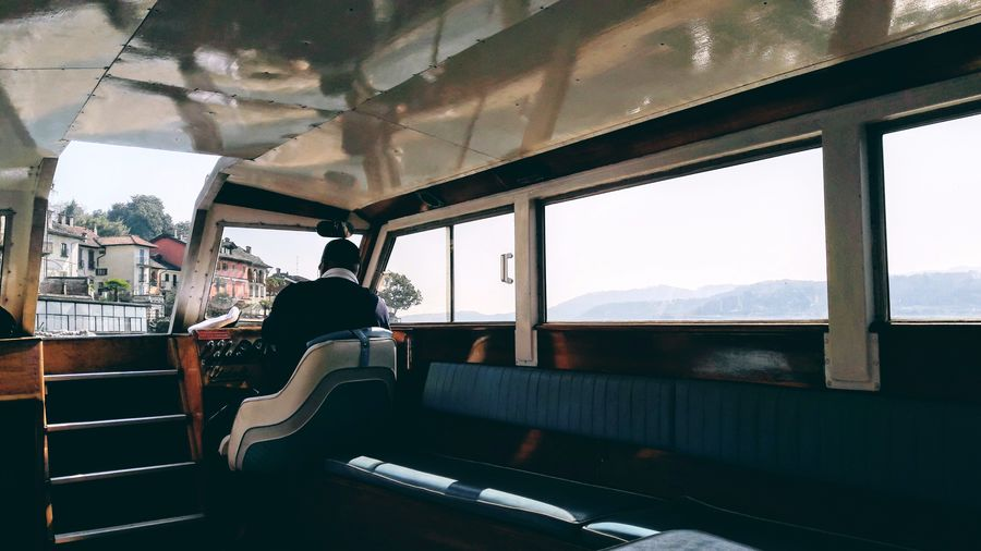 Interior Style Interior Views Boat Boating Boat Trip Light And Shadow Light Sunlight Sun Holiday Holiday Moments Good Times Men Sitting Full Length Window Looking Through Window Silhouette Sky Public Transportation Shining