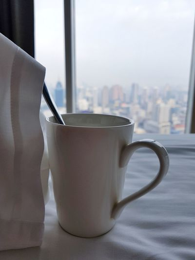 Coffee Time Coffee In Bed Coffee Cup Coffee In The City Breakfast In Bed City View  Coffee With A View Morning Coffee Bed Bedsheets White Bedroom Bedroom Window Bedroom With A View View Of The City White Cup