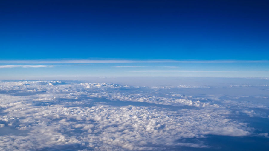 Beautiful clear blue sky over scattered of white clouds.
