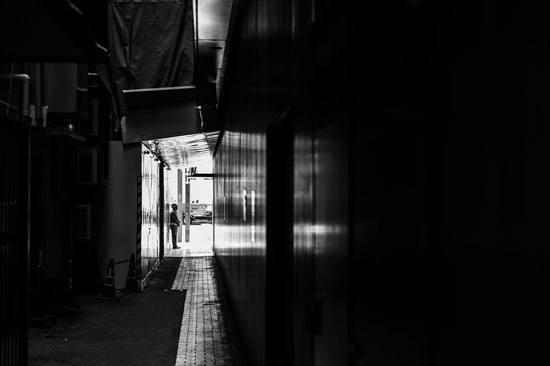 Alone In The City  Standing Security Staff Afternoon Atomosphere Tokyo Street Photography City Street Photography City Street Tokyo,Japan Tokyo Built Structure Building Exterior Building No People Direction Day City The Way Forward Dark Wall - Building Feature Street