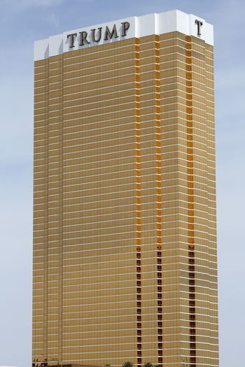Trump International Hotel Las Vegas with a 24K gold gilded glass facade Golden Las Vegas Trump Hotel USA Architecture Building Building Exterior Built Structure Business Close-up Copy Space Day Gilded Hotel Low Angle View Nevada No People Outdoors Pattern Resort Sky Skyscraper Striped Sunlight Trump