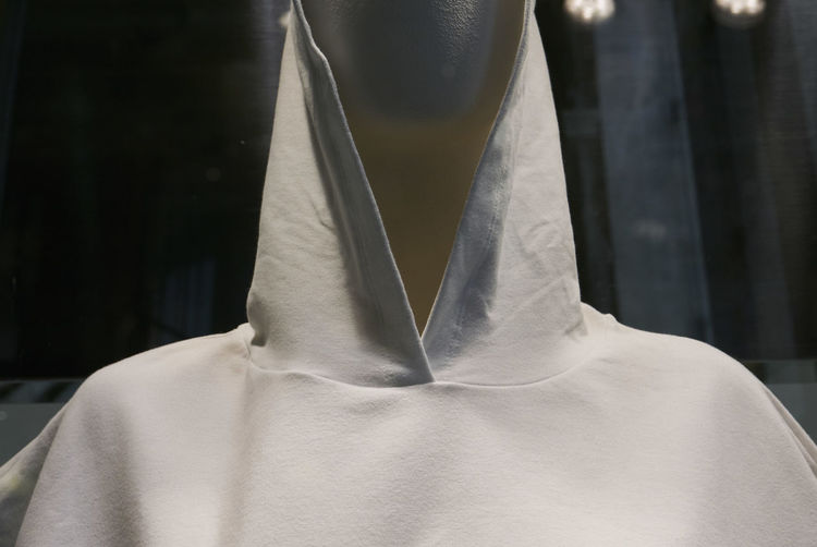 Close-up of clothing on mannequin at window display