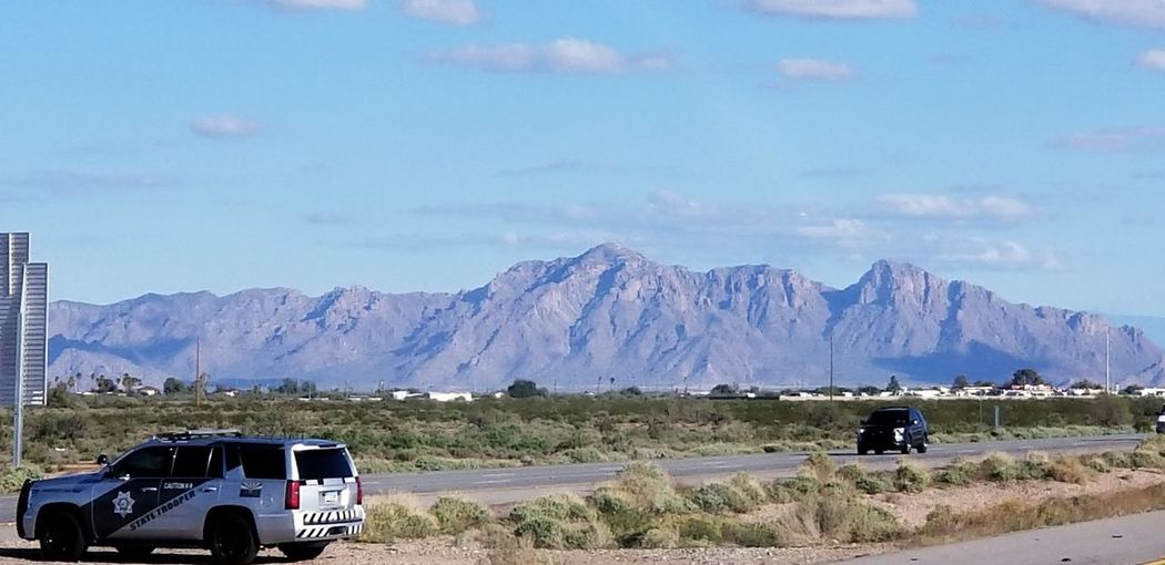 Highways Po-po Nice Picture 😉👌 Wasn't Trying To Capture The Trooper Traffic Trying To Catch Someone Speeding Highway Trooper Mountain Police Force Sky Landscape Mountain Range