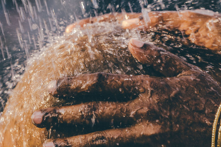 Cropped Hands Taking Shower