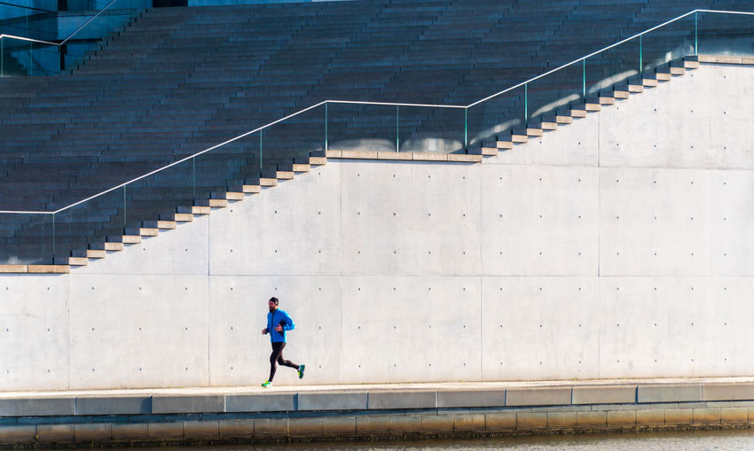 Man Jogging Against Steps