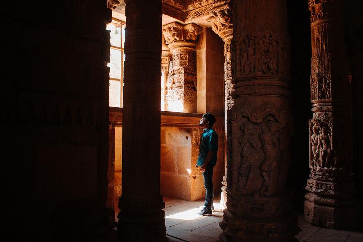 Man standing in historic building