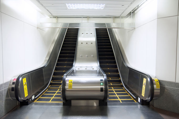 Transportation Indoors  Architecture Escalator Illuminated Convenience Technology Mode Of Transportation No People Modern Built Structure Public Transportation Airport Travel Direction Absence Connection Empty Futuristic Lighting Equipment Moving Walkway  Ceiling