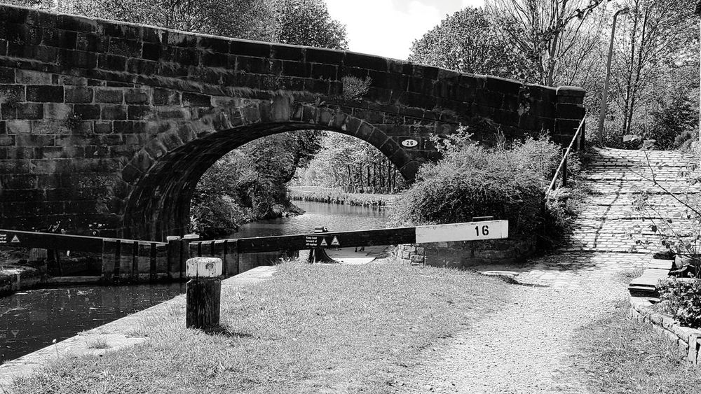 Canal bridge and lock Bridge - Man Made Structure Day Sunlight Connection Architecture No People Outdoors Built Structure Shadow Tree Nature Tranquility Eye4photography  EyeEm Gallery Samsungphotography Samsung Galaxy S6 Taking Photos Reflection Black And White Collection  Blackandwhite Photography Black And White