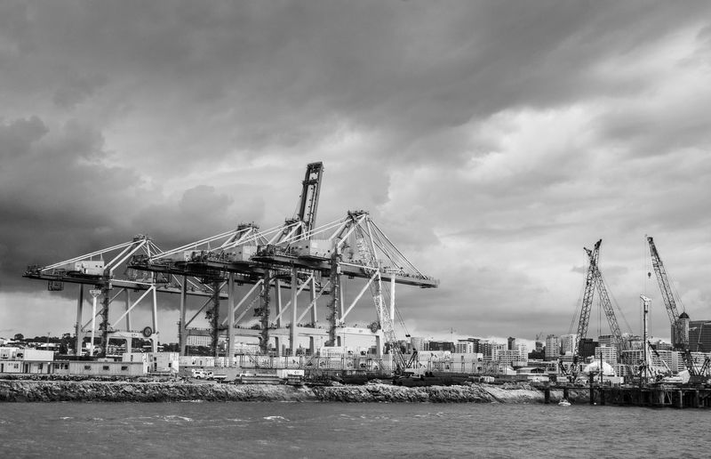 Docks Built Structure Business Cloud - Sky Commercial Dock Construction Equipment Crane - Construction Machinery Day Freight Depot Harbor Industry Machinery No People Outdoors Pier Sea Seawall Sky Transportation Water Waterfront