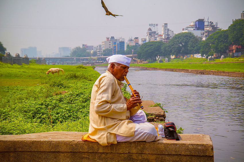 Ive been all over india to so many beautiful heritage sites, palaces, wilderness landscapes, and mountains, but its India's people who amaze me most and who have forever changed my opinion of this vast country... Just 2 hours ago I met 65 year old Mr Bankat Gaikwad, my curiosity had taken me to the banks of this river to shoot the wandering horse, when along came this old man who sat nearby me. A few moments of muttering to each other, we realised communication was not possible, so he got out his bansuri flute and started playing (something that he's been doing since 14 years old). A divine moment, as we both just looked out at the Mula river, watched eagles fly and horses grazing. Eventually I asked my driver to come to translate. Mr Bankat told me he comes regularly here to play by himself in peace, and asked me to come again tomorrow when he will use his flute with portable loudspeaker to attract snakes (today his batteries ran out). I did a double take, what?!?! are they poisonous I asked, yes was the reply. As a I shook hands with Mr Gaikwad, I walked very carefully back to my car looking down at my feet. I'm so privileged to have these moments to capture, and I love this country more and more. Traveling Candid Nature The Portraitist - 2015 EyeEm Awards