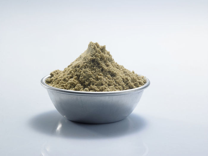 bowl of ground cumin on the white background Container Natural Aroma Bowl Close-up Condiment Cumin Food Food And Drink Fragrance Freshness Green Color Ground - Culinary Healthy Eating Herb Herbal Medicine Indoors  Ingredient No People Pile Seasoning Spice Still Life Studio Shot White Background
