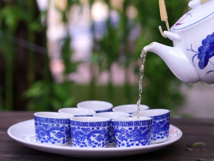 tea cup Blue Bowl Ceramics Close-up Container Crockery Cup Day Flowing Focus On Foreground Food And Drink Metal Motion Nature No People Outdoors Pouring Purple Selective Focus Table Water