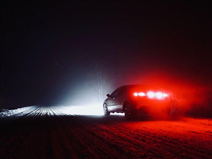 Car on illuminated road at night
