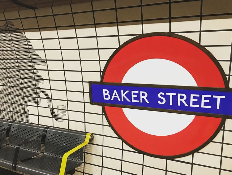 Baker Street and Sherlock Sherlock Tube Tube Station  Communication Guidance Text Road Sign No People Day Indoors  Low Angle View Close-up