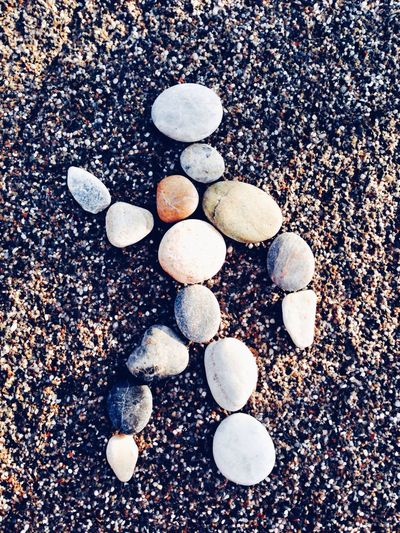 Pebbles With Artwork On Sand